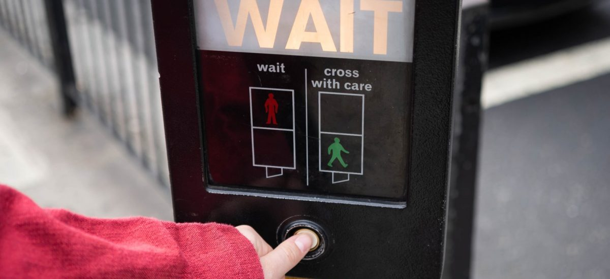 photo-of-person-pressing-the-button-of-pedestrian-box-1827232 (1)